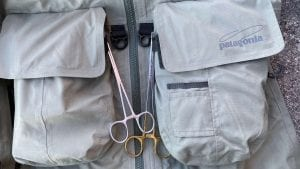 fly fishing pliers on wading jacket