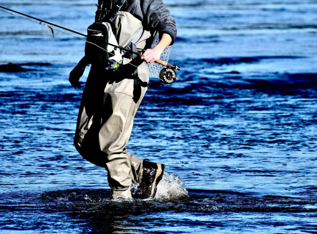 Fly Fisherman with Waders and Wading Boots