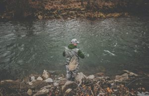 Fly fishing net attached to wading belt