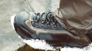Simms Wading Boots with snow in river