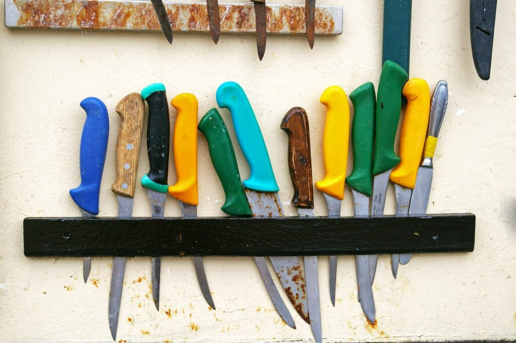 Review of the best fillet knives: fillet knives on a wall