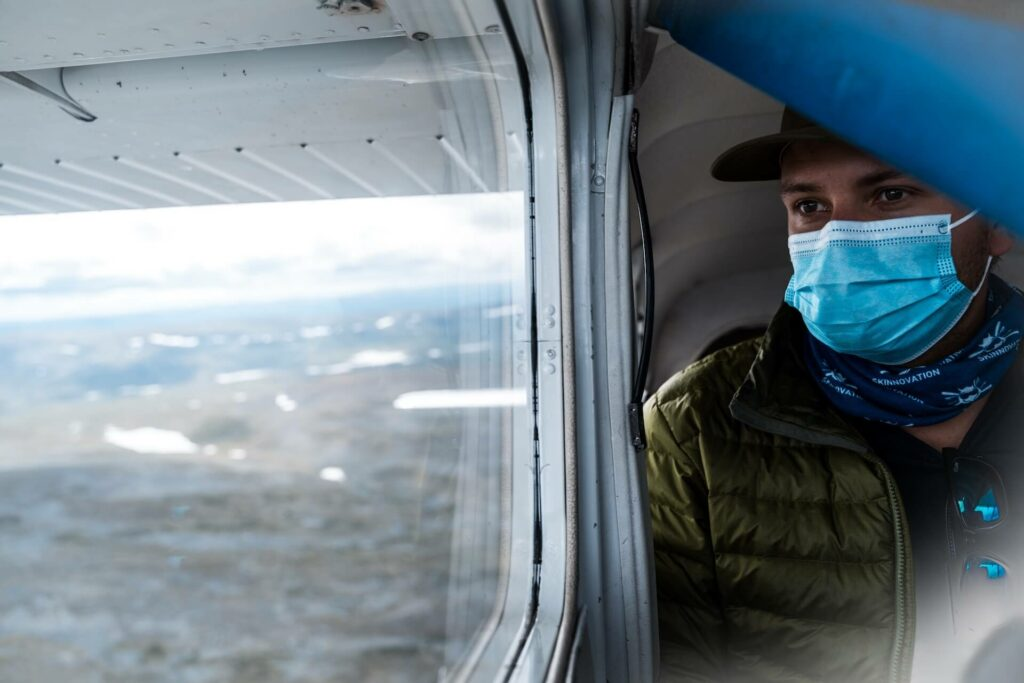 Wearing a mask on a float plane after fishing finnmark