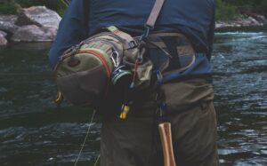 A Fly Fisherman with a Fly Fishing Hip Pack