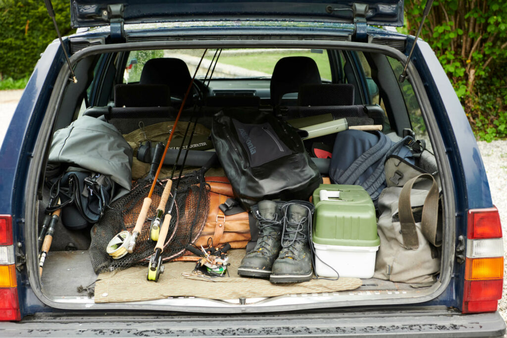 Fly fishing gear in the trunk of a car