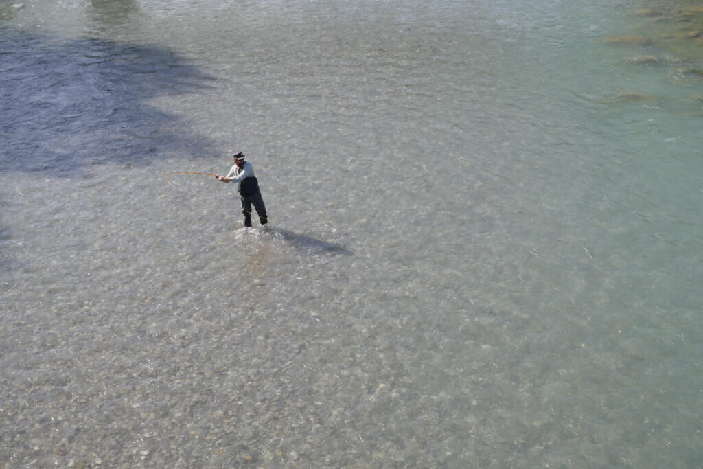 Fly fisherman in water on the Bregenzer Ache