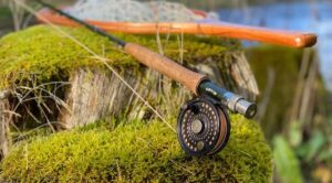 An Orvis Travel Fly Rod on Grass by the river