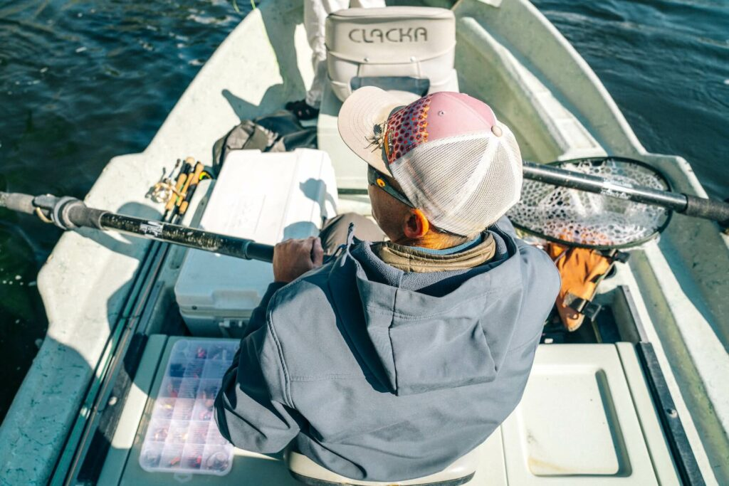 A fishing cooler in a drift boat while fly fishing